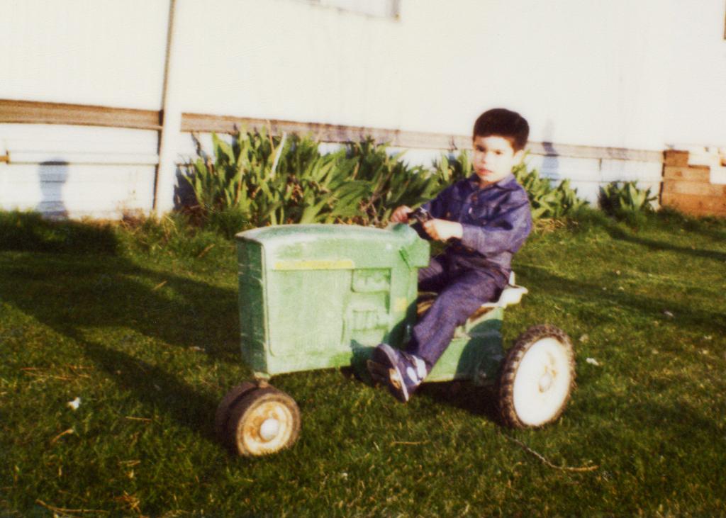 Henry Alva on a John Deere Toy Tractor