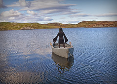 The Watcher.. (Harleynik Rides Again.) Tags: juxtaposition boat facelessportrait backshot outerhebrides loch witch gothic woman isleoflewis harleynikridesagain