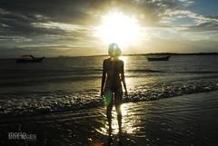 A Different Pose (MARIO BOURGES) Tags: blue sun black sol praia beach yellow azul clouds boat model do barco shine little wave preto modelo amarelo nuvens ilha pequena brilho onda silhueta silhouett superagui