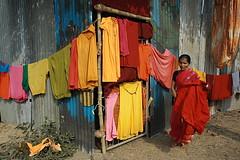 drying petticoats   Kolkata (arnabchat) Tags: light red woman india color colors sunshine lady colorful favs kolkata bengal calcutta petticoat bangla pilgrim sankranti drying garment westbengal 1740f4l makarsankranti arnabchat arnabchatterjee gangasagartransitcamp