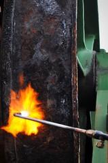 Flame Cleaning (Rob-In-Transit) Tags: orange black green yellow 50mm nikon rust marine singapore industrial machine rosebud equipment torch maritime af nikkor shipyard jurong windlass d90 f14d brakedrum
