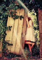 Curiosity (AIeksandra) Tags: wonderland fairytale mysterious secretgarden giardinosegreto misterioso giardino magico paesedellemeraviglie doors light woman portrait serbia balkans montenegro rays fantasy summer