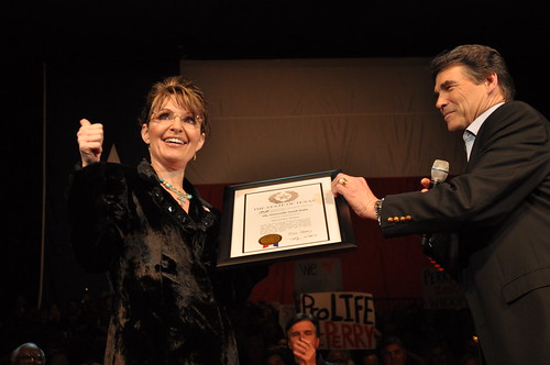 Rick Perry(R) and Sarah Palin(L),Sarah Palin accepting a plaque from Rick Perry making her an honorary Texan.