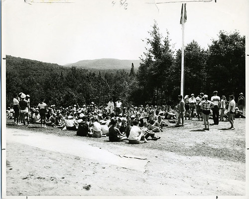 flagpole sitting. of campers sitting on lawn