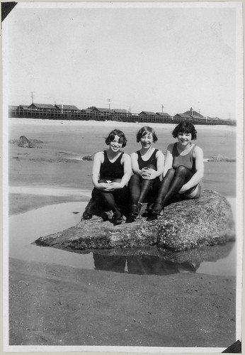 Three nymphs on a rock.