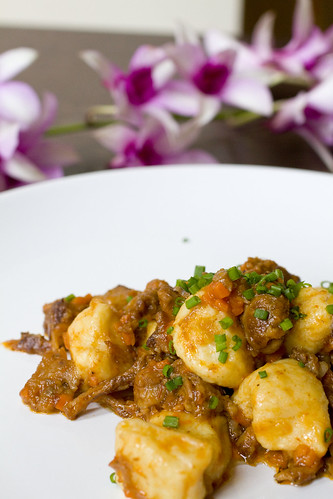Parsnip Gnocchi with Oxtail and flower background
