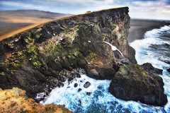 'The Bird's Nest', Reykjanesta, Iceland (WanderingtheWorld (www.LostManProject.com)) Tags: ocean cold water birds rock misty landscape lava coast iceland high haze waves break view dynamic windy cliffs formation fields northern range grounds hdr steep nesting roughwater blacksands reykjanesta canon50d southwestpoint blackbeaches