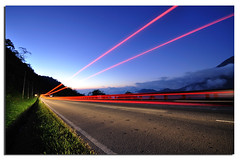 Light Trails (Nora Carol) Tags: trails lighttrails theroad malaysianphotographer noracarol sabahanphotographer bagusbangeeeeeet hahagetalifenorad heisbusyasaghostchoreographertoo iwanthavethiskindofshotaswell iambusydoingsomerealphotographywork landscapephotographerfromsabah womanlandscapephotographer womaninphotography