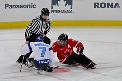 Sledge Hockey: Canada vs Italy (mariskar) Tags: italy canada ice hockey vancouver nikon competition ubc tournament stick puck olympics sled thunderbird sledge 2010 paralympics wintergames vancouver2010 d90 thunderbirdstadium sledgehockey gocanadago sledhockey nikond90 ubcthunderbird