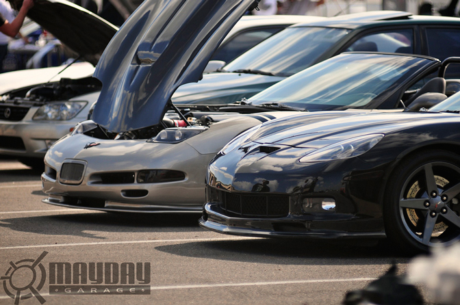 A pair of Vettes mingle with the Supras