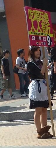 A maid standing on the street