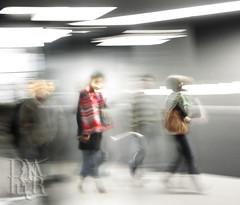 the glow (Dana Fryer) Tags: light red motion blur angel walking movement glow crowd redscarf