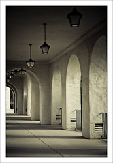 Archways & Lamps (laughlinc) Tags: california lights vanishingpoint sandiego arches repetition lamps balboapark lightroom 50mm18 nikond80 thechallengefactory laughlinc