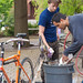 Dr. Peter Dula, bible and religion professor, works together with a student to make ice cream using a bicycle-run ice cream maker as part of the Earth Day celebrations.