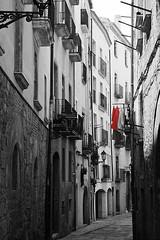 Red Dress, Tarragona, Spain (Fin Wright) Tags: road street old red canon landscape ian eos 350d landscapes calle spain catalonia polka catalunya wright fin oldtown carrer tarragona ianwright alleway esapana finwright finwrightphotographycouk finwrightphotography