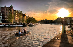 Sunset over Amsterdam (Frontpage) (Werner Kunz) Tags: world city trip travel sunset vacation sky urban holiday holland building love water netherlands dutch amsterdam clouds photoshop river boat town nikon europa europe urlaub wideangle center stadt romantic 100 40 dri hdr hdri werner reise niederlande kunz photomatix 20f
