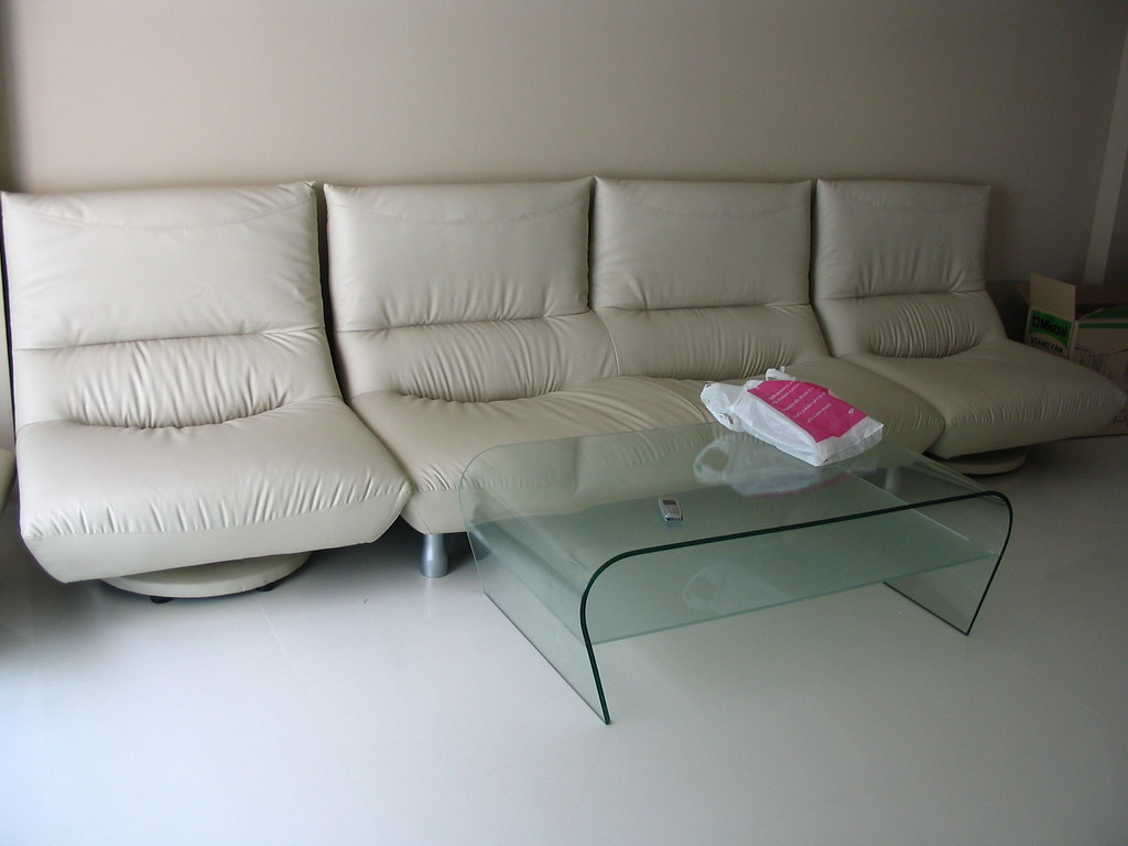 Classy Glass Coffee Table ($150) and 1 Seater Leather Chair ($150)