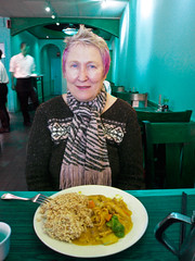 Lunch With Beautiful Sally at the Red Jade (Walker Dukes) Tags: blue food woman white black green smile metal shirt silver pepper handle lights eyes arch chairs salt plate fork fringe mature tables teapot walls lovely shakers waiter middleaged