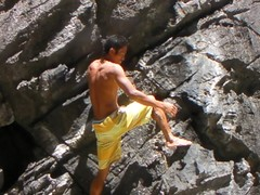 Our guide free rock climbing at Secret Beach in El Nido, Philippines (This World Rocks) Tags: trip vacation video southeastasia philippines sanyo filipino rockclimbing elnido palawan waterproofcamera sanyoxacti sanyoxactivpce2 waterproofcamcorder