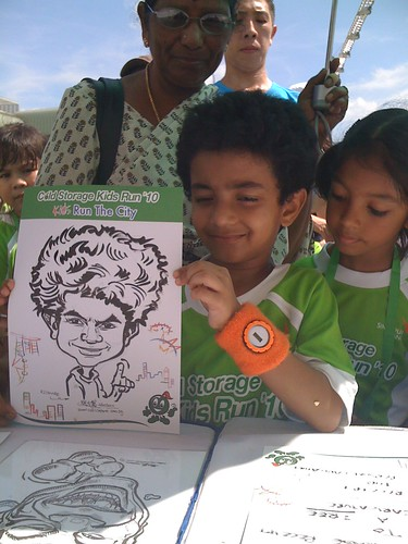 caricature live sketching for Cold Storage Kids Run 2010 - 18
