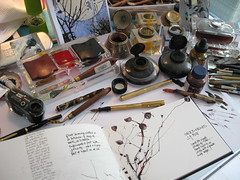 Workspace and source image (skyeshell) Tags: drawing sketchbook workspace calligraphy inkwells seedheads fountainpens artiststools paletteknifeandpens oldinkwellcollection workingfromanimage drawingandsourcematerial