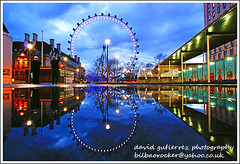 London Eye (david gutierrez [ www.davidgutierrez.co.uk ]) Tags: pictures city travel blue light england sky people urban cloud colour reflection london eye art beautiful rain architecture modern night clouds reflections wonderful dark puddle photography photo fantastic cityscape darkness image britain dusk so