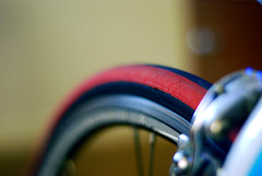 Red Wall Tire (00Accord4cyl) Tags: road blue red bike bicycle trek gold focus dof bokeh tire chain cassette blure bontrager