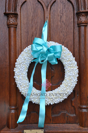 Pearl wreath on the front of St. Andrews Catholic Church