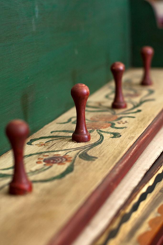 Dark burgundy knobs on ancient furniture item