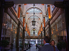 Arcade (maistora) Tags: old pink windows roof light england people orange woman man color colour london classic glass face fashion yellow shop retail architecture vintage shopping lights mirror warm commerce glow britain antique traditional arcade skylight corridor royal style tunnel stranger symmetry class historic architect gift hanging lamps lantern chic tradition posh elegant mayfair luxury lux passerby bondstreet shoppers topaz elegance upmarket oldbondstreet topazlabs maistora
