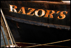 Razor's Edge (Junkstock) Tags: black color boats typography photography coast boat photo fishing graphics junk rust paint graphic photos decay rustic newengland rusty photographs photograph wharf type weathered coastline artifact distressed corrosion artifacts patina relic wharfs oldstuff fishinboats