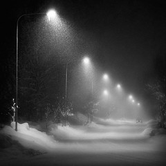 Storm II (Mikko Lagerstedt) Tags: road light shadow snow monochrome car night photoshop suomi finland dark lens landscape photography 50mm lights photo high nikon streetlight mood moody shadows dof darkness graphic streetlights unique stock perspective snowstorm atmosphere monochromatic iso explore finnish nikkor f18 sell frontpage depth stree atmospheric iso1600 mikko 2010 waterscape resize latyrx d90 nikond90 nikond90bw mikkolagerstedt lagerstedt