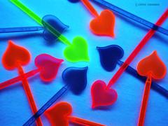 Schwarzlicht (Kati Kerber) Tags: pink blue red orange green rot yellow neon bright rosa gelb fluorescent blacklight transparency grn transparent blau pik leuchtend spade dazzling stoff schwarzlicht grell uvlicht fluoreszierend whitecotton cocktaildeko weissebaumwolle