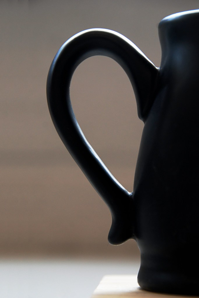 The curvy handle of a cup.