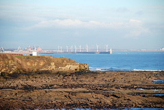 Blyth Harbour from Collywell Bay 14th February 2010 (DavidWF2009) Tags: blue sea cliff sun beach rocks waves harbour northumberland blyth windturbines seatonsluice collywellbay