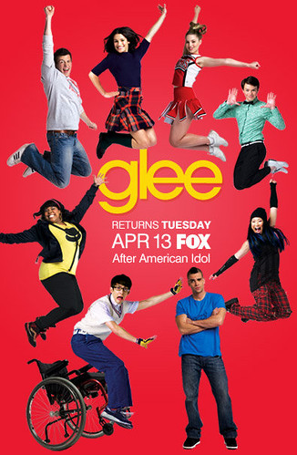 glee poster with singers jumping for joy against a red background. Artie, instead of jumping, is falling out of his wheelchair.