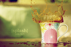 03-04-10 Splash ~ Explored :) (ethan) Tags: water coffee speed print lens 50mm high cookie colours tea retro mug daisy manual colourful splash pentacon f18 liquid mywinners cookiesplash