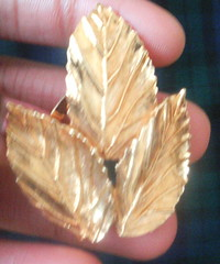 Gold three leaf brooch