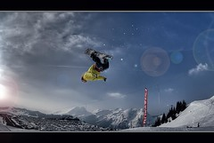 Jump out of bounds (Original) (iPh4n70M) Tags: park blue sky mountain snow ski france alps clouds montagne alpes french photography photo jump nikon freestyle raw photographer photographie skiing board fisheye bleu ciel photograph single tc snowboard neige nikkor nuage rider hdr saut snowpark acrobatic avoriaz photographe nikkon 105mm acrobatique francelandscapes frpix tcphotography ph4n70m iph4n70m tcphotographie