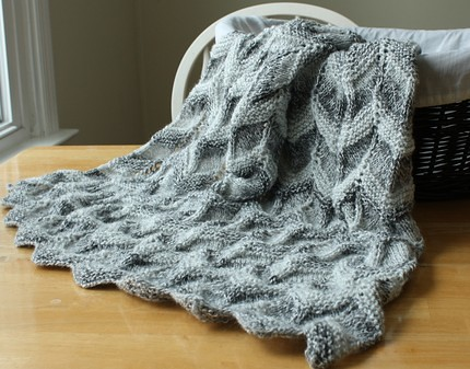 handmade Gray striped baby blanket knit in a ripple pattern