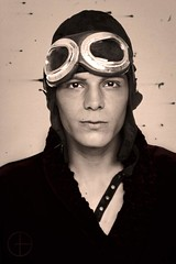 Man wearing old fashioned flight helmet and goggles (dgilder) Tags: camera old people white man male men studio person looking shot adult antique background helmet flight goggles young handsome aged damaged adults isolated 20s caucasian fashioned at dgm11