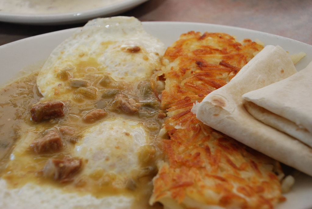 eggs with pork bits and tomatillo sauce, hash browns, tortillas
