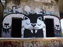 SFC- the Gatekeeper (SFCEE...Creature Ink.) Tags: bw white black abandoned wall clouds cat big doors pyramid character evil area bones paws spraycan superfatcat