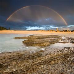 currumbin rainbow (Pawel Papis Photography) Tags: ocean morning sea sky seascape colour beach water sunrise landscape rainbow rocks foreground currumbin goldcoast vertorama