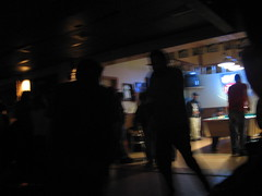 Blurry shot of the dancefloor and pool tables at the Pipeline Club.