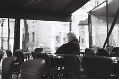 Le caf des artistes (Airicsson) Tags: street old winter urban blackandwhite bw white man black paris france film seine bar vintage la cafe noir minolta hiver nb smoking 101 latin quarter streetphoto et blanc ilford sorbonne srt101 2010 quartier streetshot srt analogique