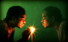 Devil & Angel (dipu10dhaka) Tags: light green angel canon fire interesting ray duet human devil candel 1000d