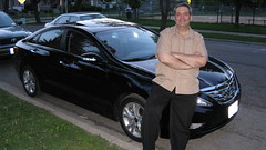 My buddy Anthony C posing by his recently purchased Hyundai Sonata. Oak Park Illinois. May 2010.