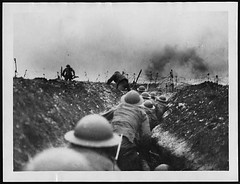 Officer leads the way amidst the bursting of German shells