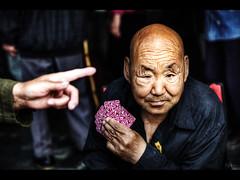 Hand of god (Kaj Bjurman) Tags: china playing man dark eos beijing card 5d kina hdr kaj markii cs4 photomatix bjurman